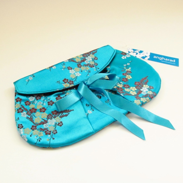 turquoise jacquard clutch bag