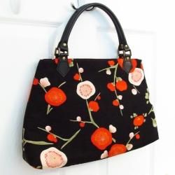 leather-handled plum blossom handbag